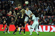 Lucy Bronze of England Women is challenged by Simone Laudehr of Germany Women<br /> - Womens International Football - England vs Germany - Wembley Stadium - London, England - 23rdNovember 2014  - Picture Robin Parker/Sportimage