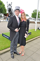 Cricketer GRAEME SWANN and his wife SARAH at the Investec Derby at Epsom Racecourse, Epsom, Surrey on 4th June 2016.