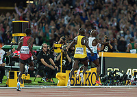 Athletics - 2017 IAAF London World Athletics Championships - Day One<br /> <br /> Event: Men's 10000 Metre Final<br /> <br /> Mo Farah (GBR) Arms outstretched poses as he crosses the line for the awaiting media<br /> <br /> COLORSPORT/DANIEL BEARHAM