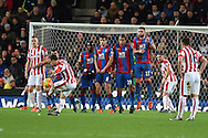 the Crystal Palace wall does it's job to block a free-kick by Xherdan Shaqiri of Stoke city. Barclays Premier league match, Stoke city v Crystal Palace at the Britannia Stadium in Stoke on Trent, Staffs on Saturday 19th December 2015.<br /> pic by Andrew Orchard, Andrew Orchard sports photography.