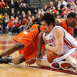 Rutgers Scarlet Knights forward Gilvydas Biruta (55) grabs a loose ball away from Syracuse Orange guard Scoop Jardine (11) during second half NCAA Big East basketball action between #2 Syracuse and Rutgers at the Louis Brown Athletic Center. Syracuse defeated Rutgers 74-64.