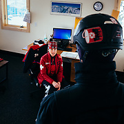 Jen Calder discussing operations for the day with a fellow ski patroller.