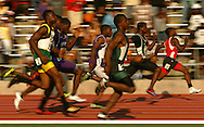 Competitors run the 5A 100 meter dash on Saturday at the UIL State Track & Field Championships in Austin on May 14, 2007.