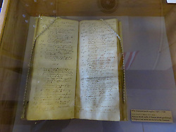 © Licensed to London News Pictures. 21/03/2017. London, UK. The ancient burial register on display, showing the official death record of Pocahontas in the town. Gravesend commemorates the death and burial of Pocahontas in the town 400 years ago today - a parade commenced at St Andrew's Gardens by the side of the river Thames where she would have come to shore on this day 400 years ago having been taken ill on board a ship sailing out of London. Water brought across from Jamestown was poured into the Thames watched by civic dignitaries and native American chiefs at the waters edge. Photo credit: Graham Long/LNP