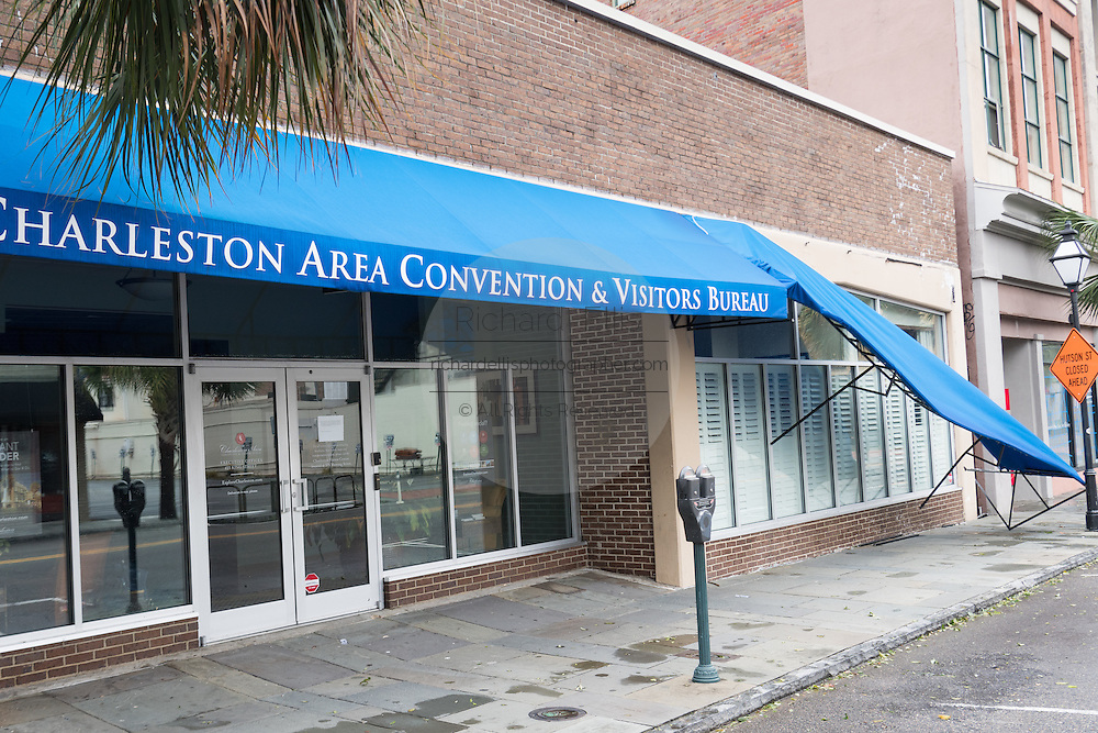 The awning on the visitors bureau hangs damaged on King Street in historic downtown after Hurricane Matthew passed through causing flooding and light damage to the area October 8, 2016 in Charleston, South Carolina. The hurricane made landfall near Charleston as a Category 2 storm but quickly diminished as it moved north.