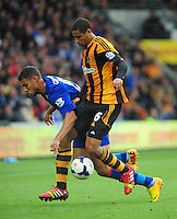 Cardiff City's Rudy Gestede is tackled by Hull City's Curtis Davies <br /> <br /> Photo by Chris Vaughan/CameraSport<br /> <br /> Football - Barclays Premiership - Hull City v Cardiff City - Saturday 14th September 2013 - Kingston Communications Stadium - Hull<br /> <br /> © CameraSport - 43 Linden Ave. Countesthorpe. Leicester. England. LE8 5PG - Tel: +44 (0) 116 277 4147 - admin@camerasport.com - www.camerasport.com