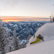 Forrest Jillson finding explosive powder right as the sun finds a gap in the horizon.