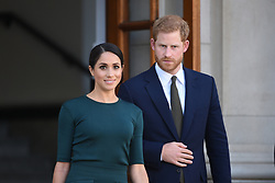 The Duke and Duchess of Sussex leave Government Buildings following a meeting with Taoiseach, Leo Varadkar (right) during their visit to Dublin, Ireland.
