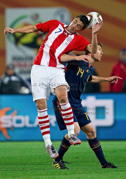 03-07-2010 VOETBAL: FIFA WORLDCUP 2010 SPANJE - PARAGUAY: JOHANNESBURG<br /> Kwartfinale WC 2010 Oscar Cardozo of Paraguay vs Xabi Alonso of Spain<br /> ©2010-FRH- NPH/ Vid Ponikvar (Netherlands only)