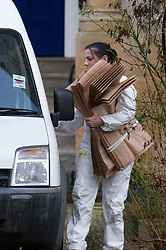 © under license to London News Pictures.  05/01/2011 A CSI places items from the flat in a van at the flat of Jo Yeates, whose body was found on Christmas Day 2010. The investigation continues, with new information being released today (05/01/2011) regarding a missing sock. Picture credit should read: David Hedges/LNP