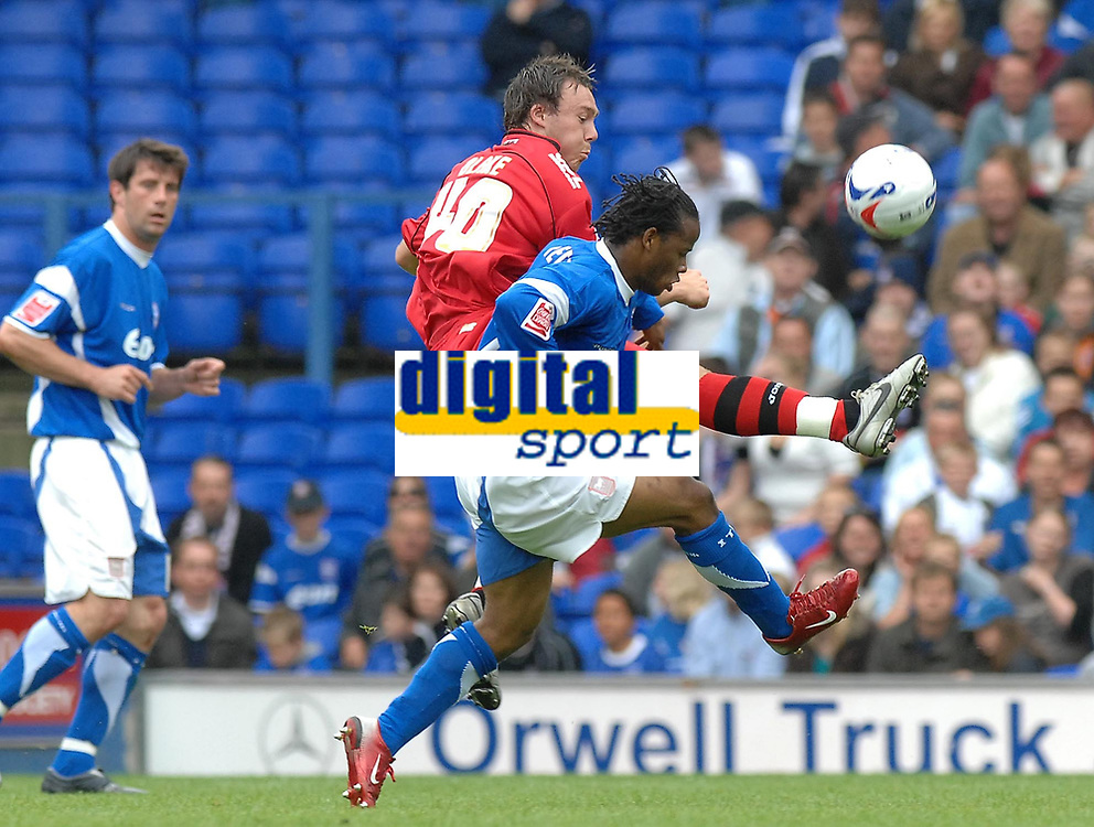 Photo: Ashley Pickering.<br /> Ipswich Town v Cardiff City. Coca Cola Championship. 06/05/2007.<br /> Cardiff's Darcy Blake (red) and Ipswich's Jaime Peters