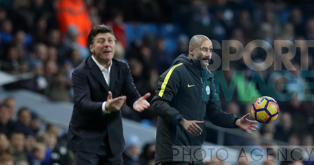 Manchester City Manager Pep Guardiola andWalter Mazzarri during the English Premier League match at The Etihad Stadium, Manchester. Picture date: December 12th, 2016. Photo credit should read: Lynne Cameron/Sportimage