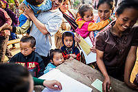 The JE vaccination campaign in Khon Kahndone Village, Xieng Khouang province, Laos.