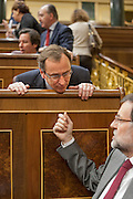Mariano Rajoy speaks with colleague and representative Alfonso Alonso Aranegui