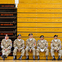 110912       Brian Leddy<br /> Area veterans sit on benches at Tohatchi High School after the posting of colors Friday. The school held an early Veteran's Day celebration to honor area veterans.