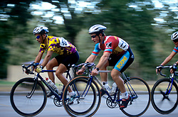 Stock photo of a group of cyclists racing through the street