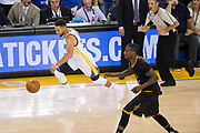 Golden State Warriors guard Stephen Curry (30) pushes the ball down the court during Game 2 of the NBA Finals against the Cleveland Cavaliers at Oracle Arena in Oakland, Calif., on June 4, 2017. (Stan Olszewski/Special to S.F. Examiner)