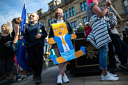 © Licensed to London News Pictures . 03/06/2019. Manchester, UK. A placard featuring Donald Trump wearing a nappy is held by a protester . A Manchester Together Against Trump demonstration in Cathedral Gardens , central Manchester , during the first day of US President Donald Trump's visit to the UK . Photo credit: Joel Goodman/LNP