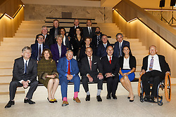 (Left to right, bottom row) Deyan Sudjic, Director of The Design Museum, Jill Ritblat, Sir Terence Conran, Prince Philip, The Duke Of Edinburgh, Luqman Arnold, Mrs Bakala and David Constatine (left to right, second row) Sebastian Conran, John Hegarty, Anya Hindmarch, Hugh Devlin, Charles Rifkind, (left to right, third row) Alistair Johnston, Saba Nazar, Alice Black, Asif Khan (left to right, top row) Chris Frayling, Nicholas Bull and Julian Vogel attend the opening of the new Design Museum at The Design Museum in London, England.