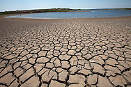 Dried mud where water was in the EV Spence Reservoir near the town of Robert Lee in West Texas  is almost dry leaving the city with little water. The Drought in Texas will have long term environmental and finical impact.