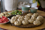Today on the Cui family's lunch menu: homemade baozi. Baozi are steamed bread filled usually with a pork mixture. (Supporting image from the project Hungry Planet: What the World Eats.) The Cui family of Weitaiwu village, Beijing Province, China, is one of the thirty families featured, with a weeks' worth of food, in the book Hungry Planet: What the World Eats.