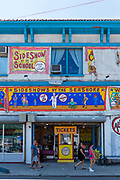 The Coney Island Museum, with its exhibits and freak show, on the corner of Surf Avenue and West 12th Street, has a recorded barker's announcement for the freak show on W. 12th. The museum entrance is through the Freak Bar on Surf Avenue.