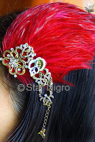 """Butterfly hairpiece/accessory<br /> one of a kind<br /> <br /> This can be worn as a hairpiece/ accessory that can also be clipped  to a blouse,pocket book,hat etc. <br /> <br /> Materials: butterfly photo,red colored  feathers,shells and swarovski crystal with barrette clip.<br /> <br /> size: 4 """" x 3 1/2"""" x 1/2""""<br /> <br /> price: $64.00<br /> <br /> <br /> + Giveback<br /> When you make a purchase from this site 7%  will be shared with a non-profit that focuses on making a positive difference in the world today.<br /> <br /> Buying art  + Making a difference = Art with Heart<br /> photo by Star Nigro<br /> <br /> StarNigro.com<br /> <br /> ©2021 All artwork is the property of STAR NIGRO.  Reproduction is strictly prohibited."""