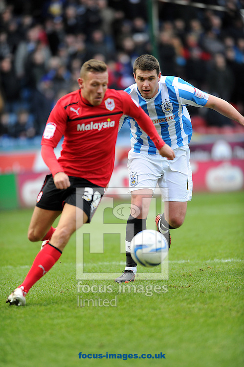 Picture by Graham Crowther/Focus Images Ltd +44 7763 140036.09/02/2013.Anthony Gerrard of Huddersfield Town fights with Craig Bellamy of Cardiff City during the npower Championship match at the John Smiths Stadium, Huddersfield.