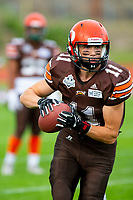 KELOWNA, BC - AUGUST 17:  Adam Burton #11 of Okanagan Sun warms up with the ball against the Westshore Rebels  at the Apple Bowl on August 17, 2019 in Kelowna, Canada. (Photo by Marissa Baecker/Shoot the Breeze)