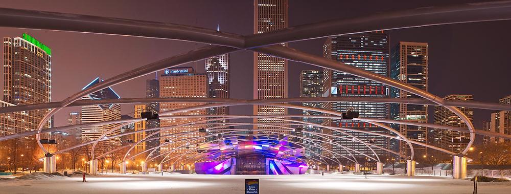 Chicago's Millennium Park Pritzker Pavilion on a March 2014 winter's evening. Frank Gehry Designed trellis and bandshell. Exterior Architectural Photography. Buildings, locations, architecture. Chicago, Illinois, built landscape,