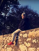 EXCLUSIVE - Justin Bieber spotted sitting on house wall