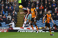 Scott Arfield of Burnley gets the ball just in front of Moses Odubajo of Hull City. Skybet football league Championship match, Burnley v Hull city at Turf Moor in Burnley ,Lancs on Saturday 6th February 2016.<br /> pic by Chris Stading, Andrew Orchard sports photography.