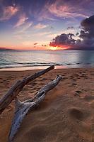 Driftwood towards the setting sun at North Kaanapali Beach in Maui, Hawaii.