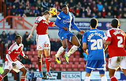 Peterborough United's Jermaine Anderson in action with Swindon Town's Darren Ward - Photo mandatory by-line: Joe Dent/JMP - Tel: Mobile: 07966 386802 11/01/2014 - SPORT - FOOTBALL - County Ground - Swindon - Swindon Town v Peterborough United - Sky Bet League One