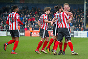 Lincoln City celebrate as Lincoln City Defender Scott Wharton  makes it 3-0 during the EFL Sky Bet League 2 match between Lincoln City and Grimsby Town FC at Sincil Bank, Lincoln, United Kingdom on 17 March 2018. Picture by Craig Zadoroznyj.