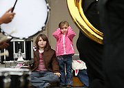 Please run as lead photo.....Gabby Shaver, right, holds her ears next to her sister Abbie as the drum section Monticello High School marching band passes during the Barracks Road's Annual Holiday Parade Friday morning in Charlottesville, Va. Photo/The Daily Progress/Andrew Shurtleff..