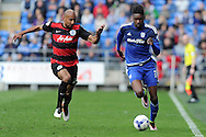Cardiff City's Sammy Ameobi (r) takes on QPR's Karl Henry. Skybet football league championship match, Cardiff city v Queens Park Rangers at the Cardiff city stadium in Cardiff, South Wales on Saturday 16th April 2016.<br /> pic by Carl Robertson, Andrew Orchard sports photography.