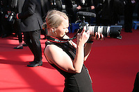 A photographer on the red carpet, Palais des festivals during the 66th Cannes Film Festival 2013