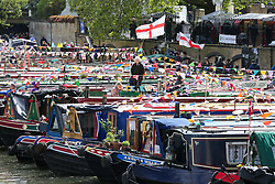 © Licensed to London News Pictures. 04/05/2019. London, UK. Inland Waterways Association's (IWA) annual gathering of over 100 decorated canal boats with bunting and flags at the annual Canalway Cavalcade festival in Little Venice canals in West London. The festival runs over the May bank holiday weekend which has been taking place since 1983. Photo credit: Dinendra Haria/LNP