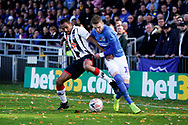 Ronan Curtis of Portsmouth under pressure from Rene Steer of Maidenhead United during the The FA Cup 1st round match between Maidenhead United and Portsmouth at York Road, Maidenhead, United Kingdom on 10 November 2018.