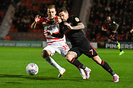 Chris Maguire of Sunderland (7) looks to get past Herbie Kane of Doncaster Rovers (15) during the EFL Sky Bet League 1 match between Doncaster Rovers and Sunderland at the Keepmoat Stadium, Doncaster, England on 23 October 2018.