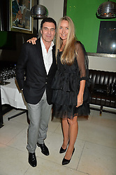 COLLETTE DINNIGAN and ANDRE BALAZS at a dinner to celebrate the publication of Obsessive Creative by Collette Dinnigan hosted by Charlotte Stockdale and Marc Newson held at Mr Chow, Knightsbridge, London on 9th February 2015.