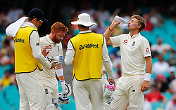 England's Joe Root takes a drink during day five of the Ashes Test match at Sydney Cricket Ground.