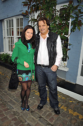 LILIYA ROGOVA and JORN WINKLER founder and Executive Vice President of DK Grou at a private view of paintings by Johnny Madsen at Mews 42 Gallery, 42 Princes Gate Mews,  South Kensington, London on 15th April 2009.