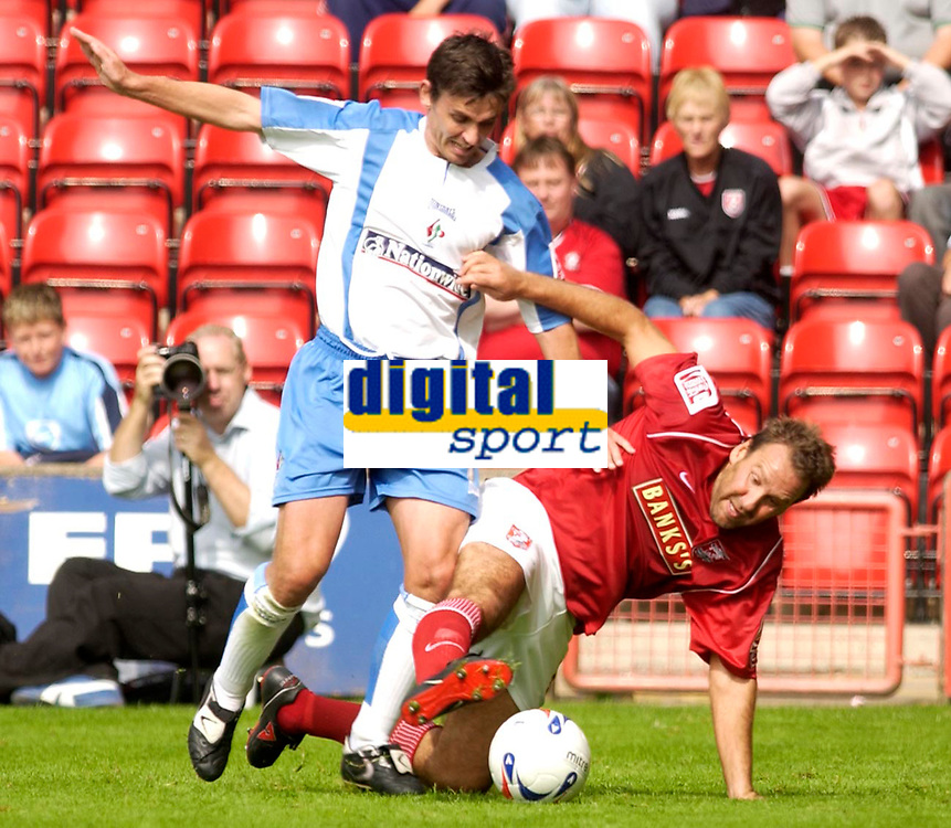 Photo: Daniel Hambury.<br />Walsall v Swindon. Coca Cola League 1.<br />03/09/2005.<br />Swindon's Gareth Whalley and Walsall's Paul Merson battle for the ball.