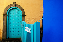 Doorway and coloured walls at Portmeirion village, designed and built by Sir Clough Williams-Ellis, Gwynedd, Wales, UK