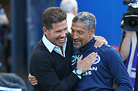 Football - 2017 / 2018 pre season friendly - Brighton and Hove Albion vs. Atletico Madrid<br /> <br /> Brighton Manager Chris Hughton shares a laugh with Atletico Madrid Manager Diego Simeone before kick off of the pre season friendly at The Amex Stadium Brighton <br /> <br /> COLORSPORT/SHAUN BOGGUST