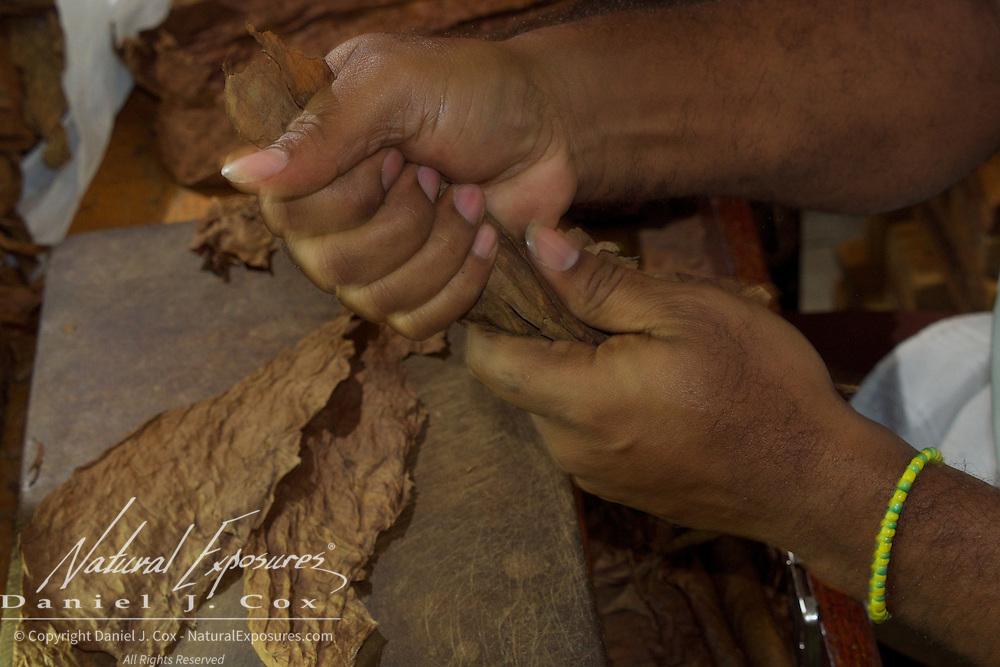 A cigar maker crafting cigars at the Cuban National Hotel in Havana, Cuba.