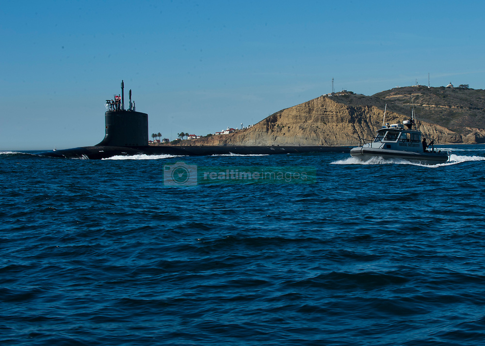 SAN DIEGO (Feb. 6, 2013) Sailors assigned to Commander Navy Region Southwest Harbor Patrol escort as Virgina-class fast-attack submarine out of San Diego Harbor during a high-value transit. (U.S. Navy photo by Mass Communication Specialist Seaman Apprentice Conor Minto/Released) 130206-N-VO234-012 <br /> Join the conversation<br /> http://www.facebook.com/USNavy<br /> http://www.twitter.com/USNavy<br /> http://navylive.dodlive.mil