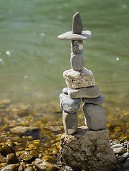 Stack of rocks balancing at riverbank, Bavaria, Germany